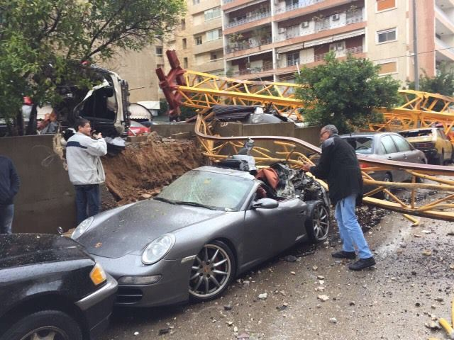 A crane in syoufi near Achrafieh fell because of strong wind damaging cars and balconies near by