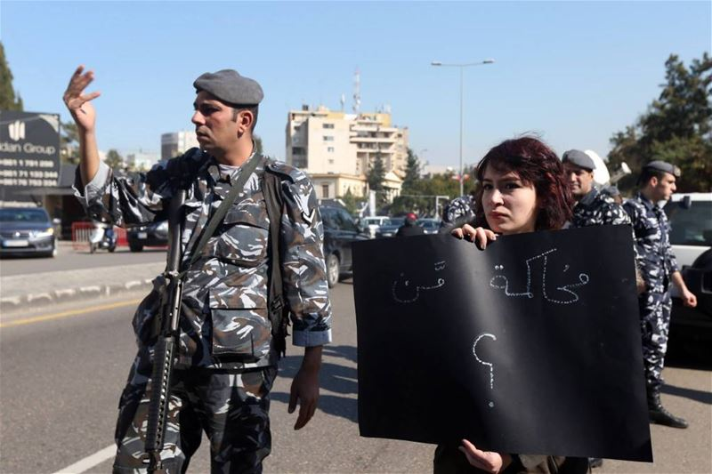 "Protesters hold banners outside Beirut's Military Tribunal, where 14 ""You Stink"" protesters were being prosecuted on charges connected to the protests against the trash crisis. (Hasan Shaaban)"