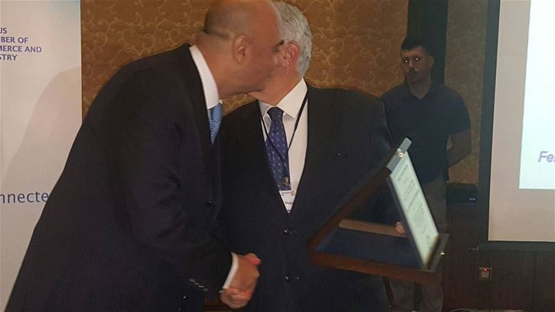 @georgeschehwane offers an award to Mr. Hajji Roussos - President of the... (Limassol, Cyprus)