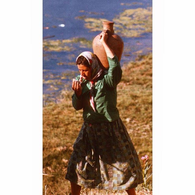 SouthLebanon Woman with their water filled jar .