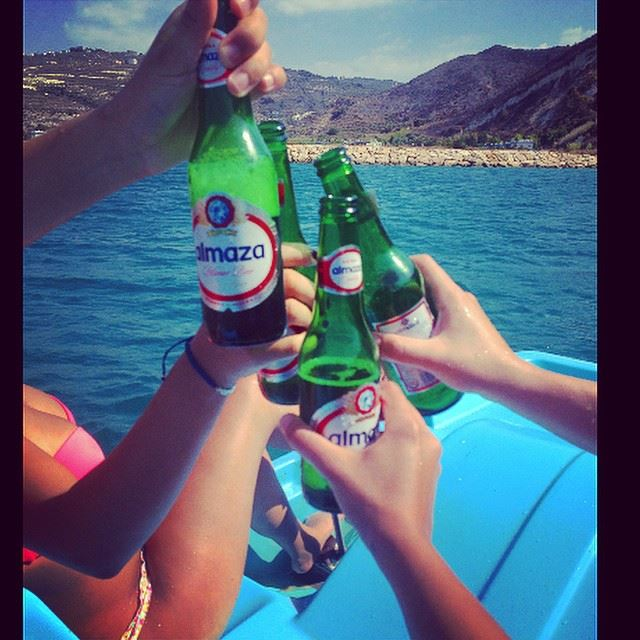 cheers  almaza  beer  middle of the  sea  mountain  view  relaxing  chill...