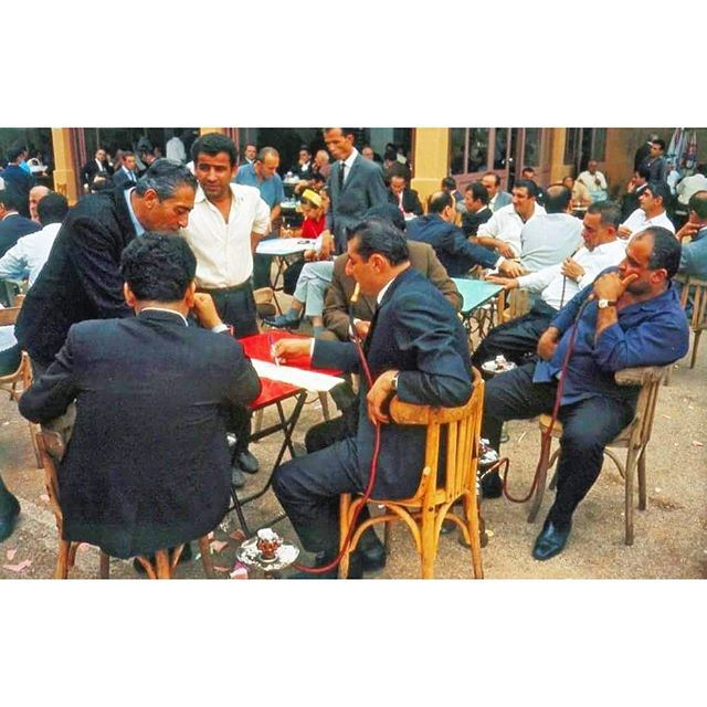 Beirut Prosperous Men Smoking Nargileh at the  horse race track and waiting for the results @beiruthippodrome 1966 .
