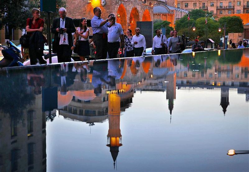 The reflection of prince Mansour Assaf mosque is seen in the water of...