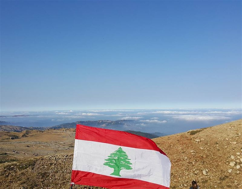 The lebanese flag @ 2300 m Red for blood and revolutionWhite for snow...