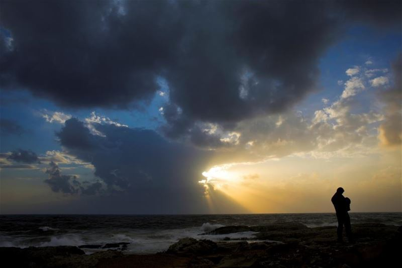 A man reviews pictures on his camera of the Rawcheh Rock, during sunset in Beirut. (Hassan Ammar / AP) via pow.photos