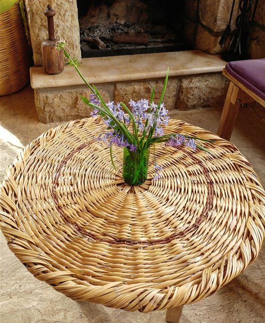 Handmade wicker tabletop and by the fireplace a wooden pestle used to... (Kfarkatra / Chouf)