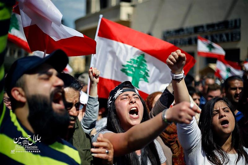 Lebanese anti-government protesters shout slogans during a protest against...