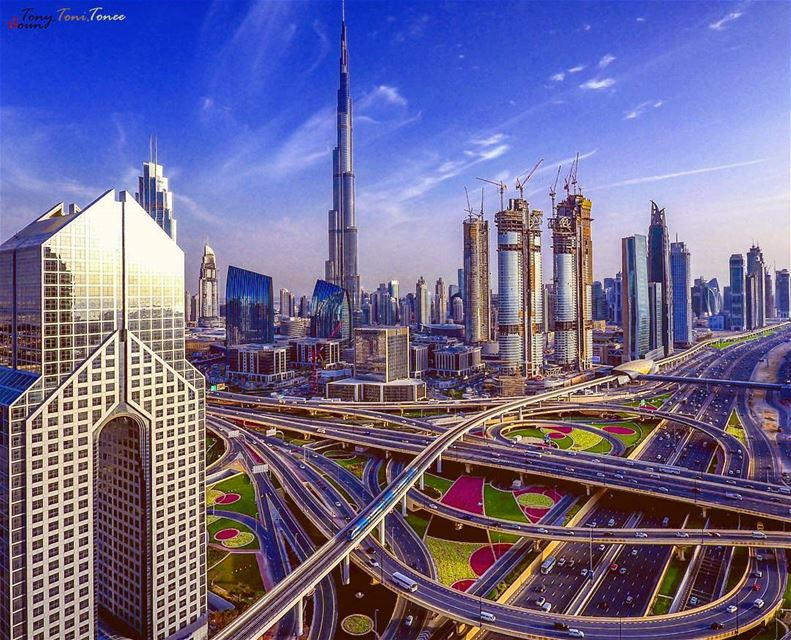 """""""Opportunity is missed by most people because it is dressed in overalls,... (Dubai, United Arab Emirates)"""