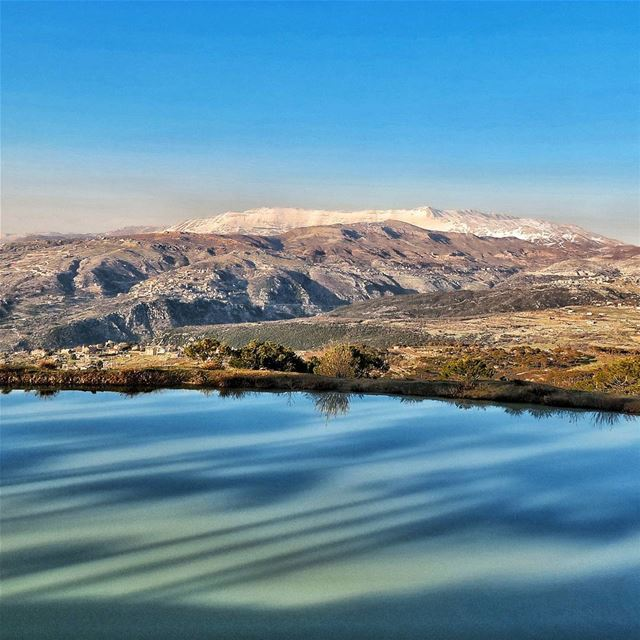Sannine, as seen from Falougha lake shadows trees mountains villages ...