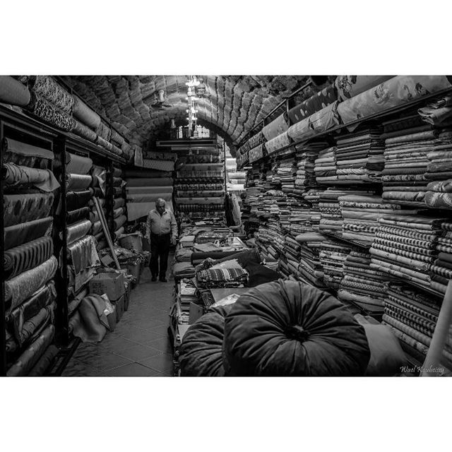 bnw cloth shop working souk blackandwhite street photography ... (Old Saida Souks)
