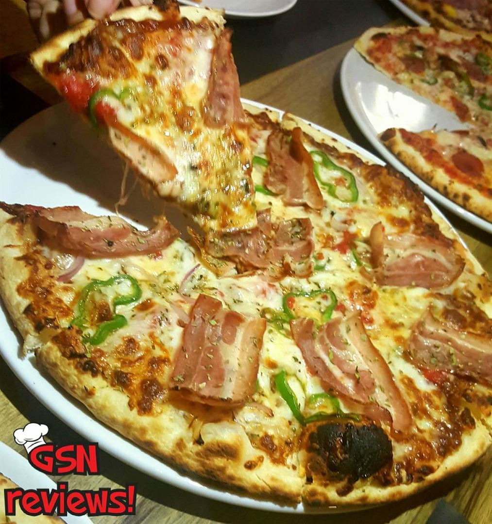 Tge Porkoi pas pizza at Micellis is really perfect and very well... (Micelli's)