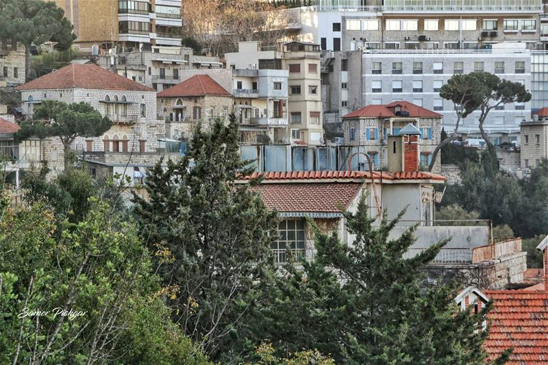 Windows and rooftops.. and a man in a white suit..Beit Meri Lebanon .....