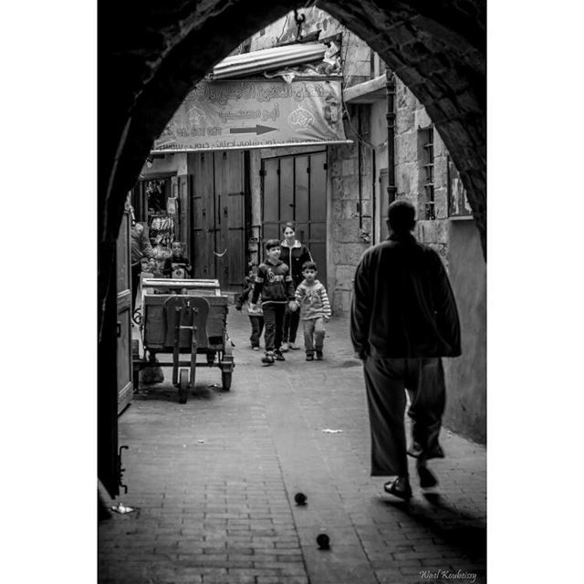 bnw man walking souk blackandwhite blackandwhite street children ... (Old Saida Souks)