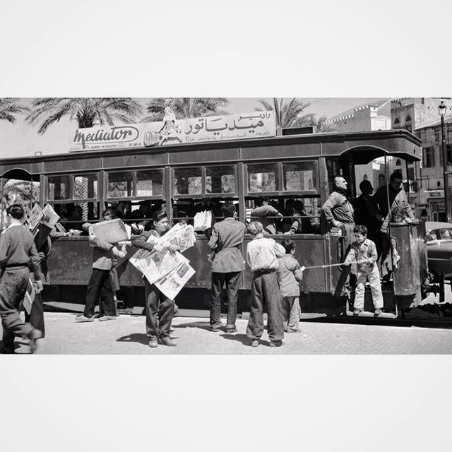 Children selling newspapers near the tramway ,