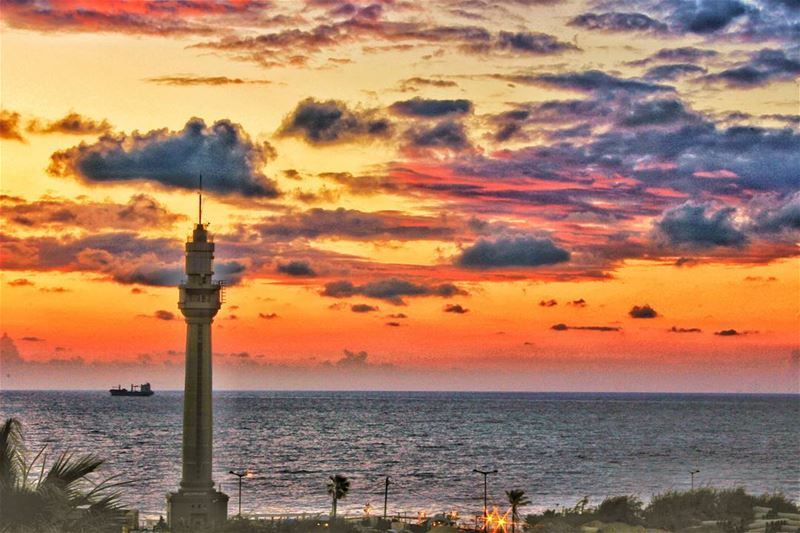 Manara colorful sunset lighthouse clouds sea orange light ship ... (Running Beirut Manara)
