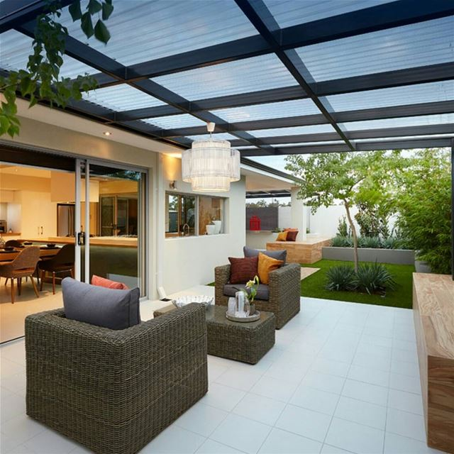 Outdoor room highlighted with planting to soften the hardscape. The...