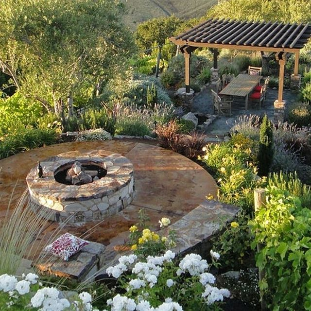 Outdoor living with a pergola , fire pit and landscape lighting. ... (Koura)