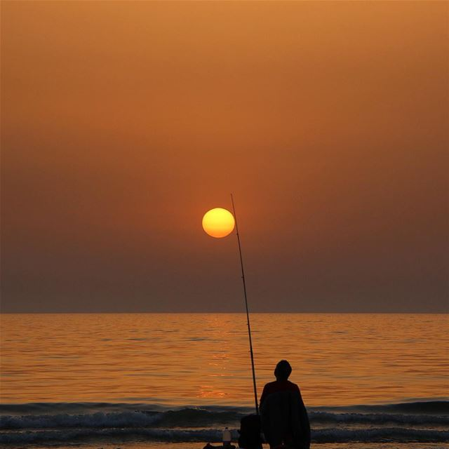And catch the sun ☀️ ... sunset sunsetlovers sunset_pics fisherman... (Ramlet El Baida Bierut Lebanon)