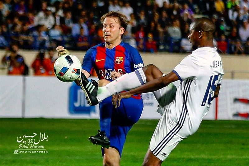 Former FC Barcelona player Gazica Zbala, left, fights for the ball with...