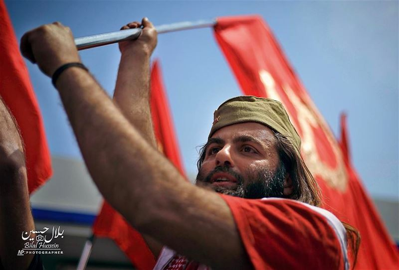A member of the Lebanese Communist party, waves the party's flag, during a...