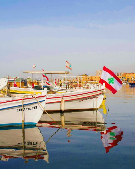 lebanon flag tyre sour boats sea water fish port blue spring ... (Tyre Fishermen Port.)