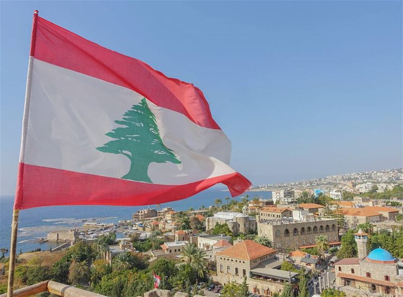 This Lebanese flag waves from the crusader citadel, that overlooks the the... (Byblos, Lebanon)