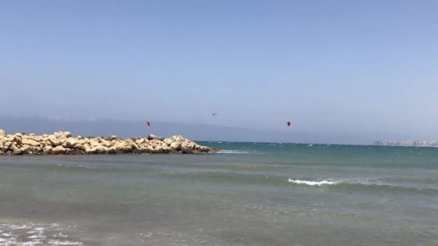 Oh it's definitely blowing wind at Tripoli's north marina  kitesurfers ... (North Marina Beach)