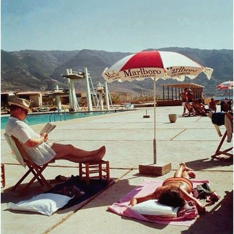 Tabarja 50 Years ago in 1965 , sunbathing leisure never changed, But the mountains behind have been invaded with concrete buildings.