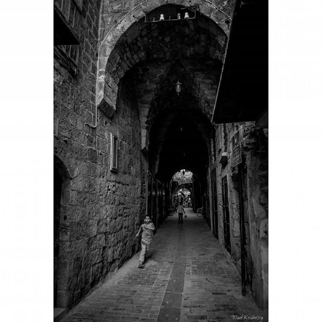 bnw child boy running blackandwhite old street photography ... (Old Saida Souks)