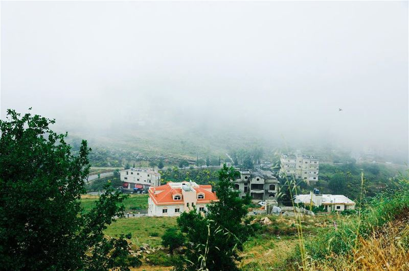 Houses in the valley, with fog covering the whole mountain behind it. My... (Bhamdoûn, Mont-Liban, Lebanon)