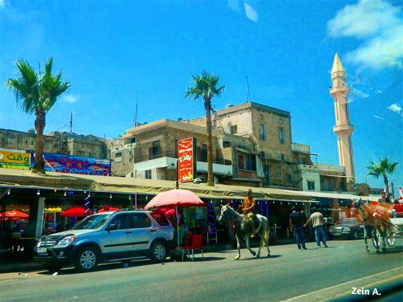 old saida horse car palm people trees street streetphotography ... (Sidon, Lebanon)