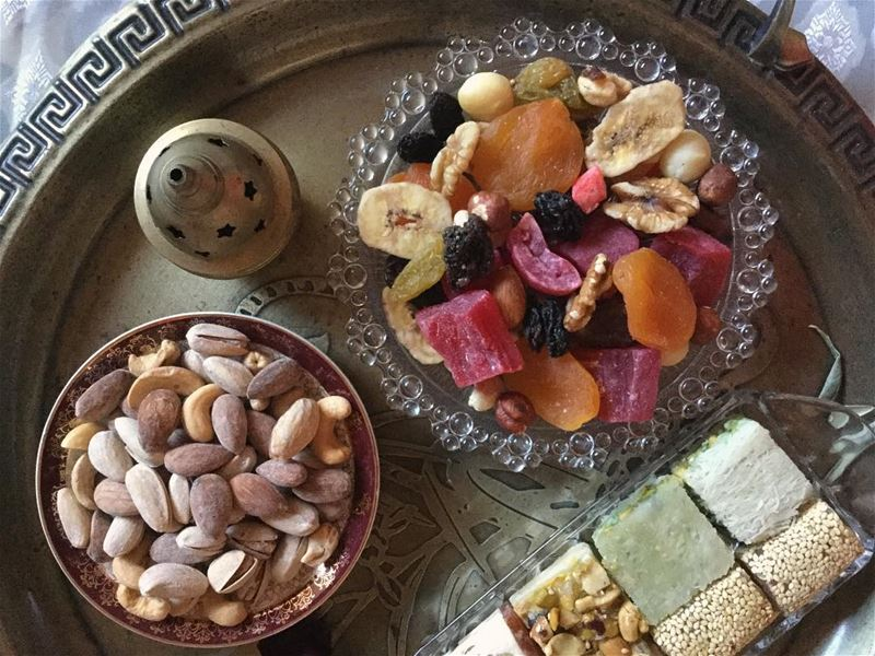 Sharing plates of dried fruit زبيب , nuts بزورات and cups of tea شاي ... (Guildford West)