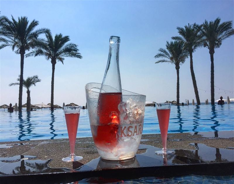 Sunset drinks 👌 lebanesebucketlisters wine rose beach pool ... (Damour, Lebanon)