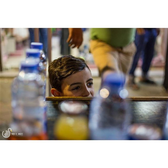 A young kid helping his father on stand in Tripoli souksTripoli is a...
