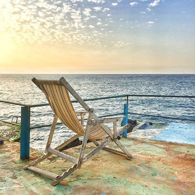 When all you need is this chair and that view @liveloveanfeh by @polsamuel (Anfeh, Lebanon)