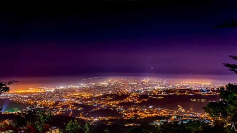Night picture of beirut, the 2 lines in the mid picture are 2 plain on...