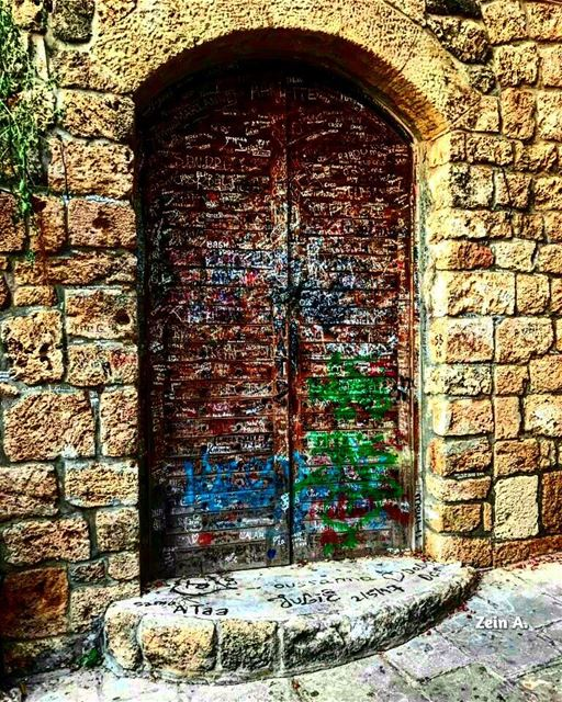 Writings on the wall door old writings noperson daylight travel ... (Jbeil-Byblos)