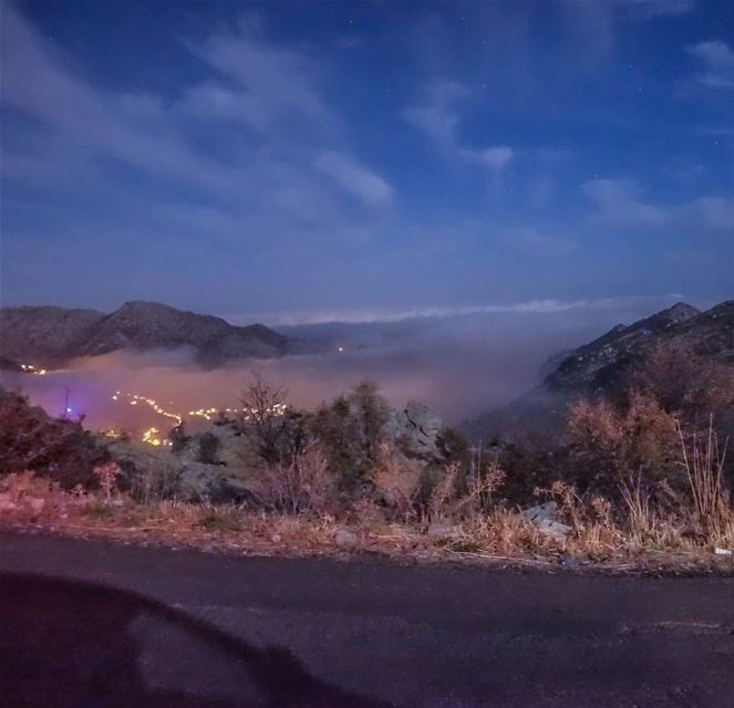 A layer of clouds blankets the sleepy villages below as night sets... (Douma, Liban-Nord, Lebanon)