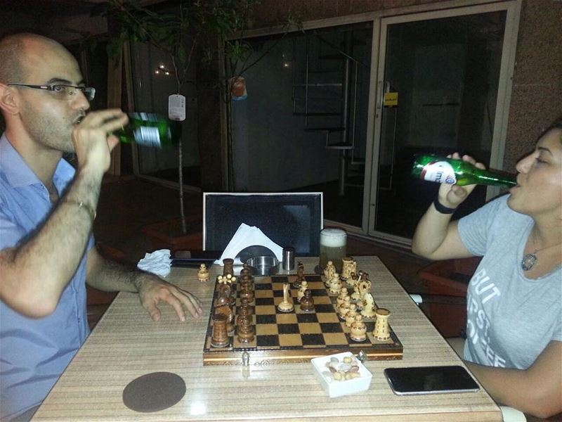 The loveliest people playing with Em's hand crafted Chess board! cheers! ... (Em's cuisine)