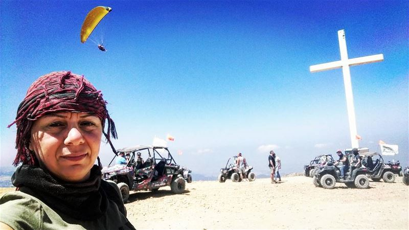 I was taking selfie with friends behind me then a paragliding showed up in...