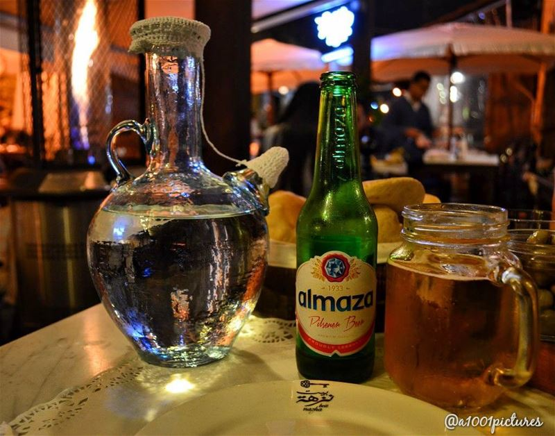 Two iconic Lebanese items:The traditional drinking water jug and Almaza... (Byblos, Lebanon)