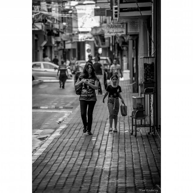 bnw  blackandwhite  street  photography  woman  sidewalk  walking  mother...