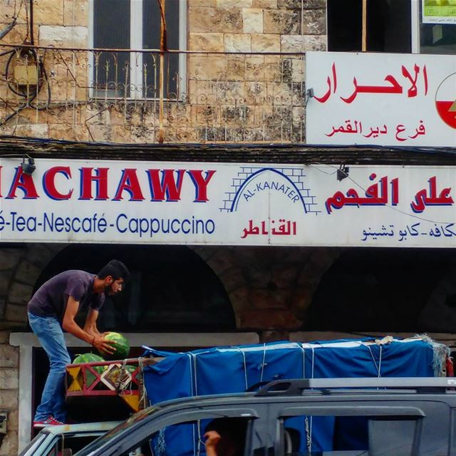 Unloading watermelons, one at a time. supplychain watermelon ... (Dayr Al Qamar, Mont-Liban, Lebanon)