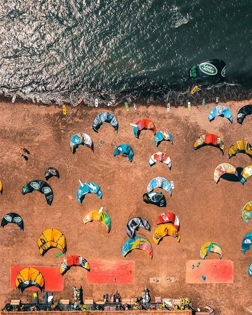 A beach invasion of colorful kites and kitersWhile Copter flies above... (KiteXtreme-Turkey/Gokova)