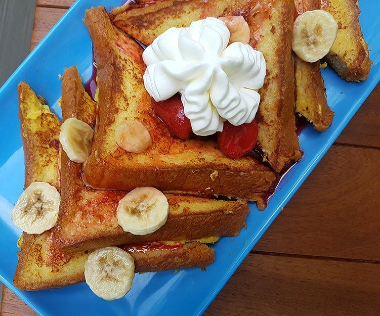 Strawberry & Banana French Toast! Super fluff stack with whipped cream on... (The Spot Choueifat)