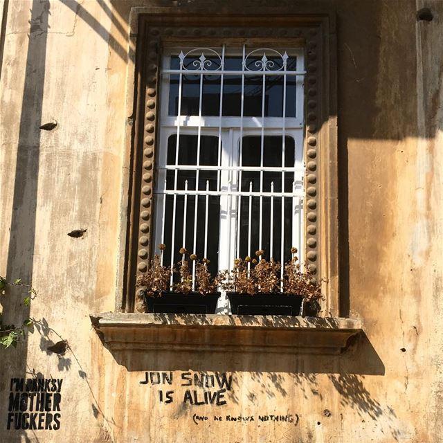 window white wroughtiron sandstone facade banksy tag marmikhael ... (Mar Mikhael Village)