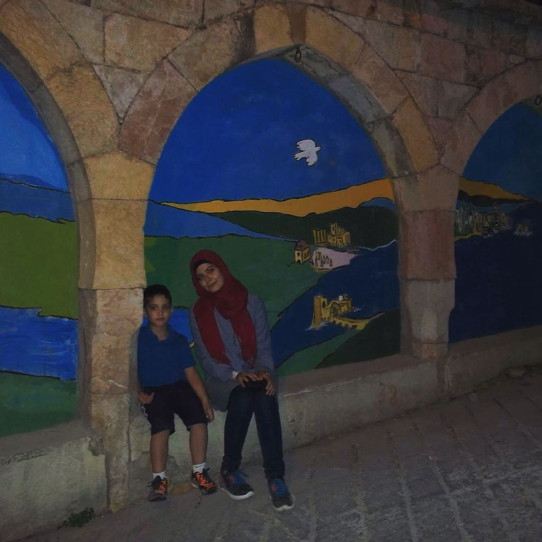 A story on walls 💙 machghara livelovemachghara blue wall night ... (Machghara, Béqaa, Lebanon)