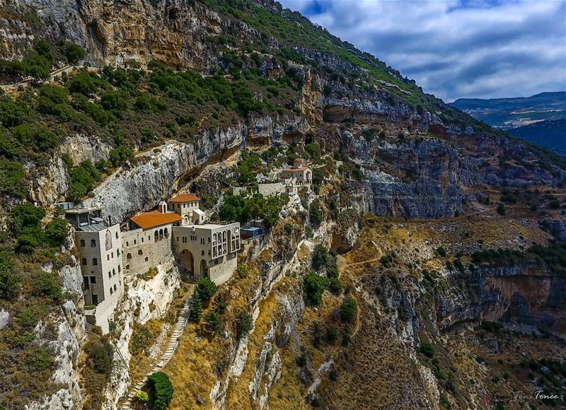 You see those paths and rooms built inside the rocks on that high mountain, (Koûsba, Liban-Nord, Lebanon)