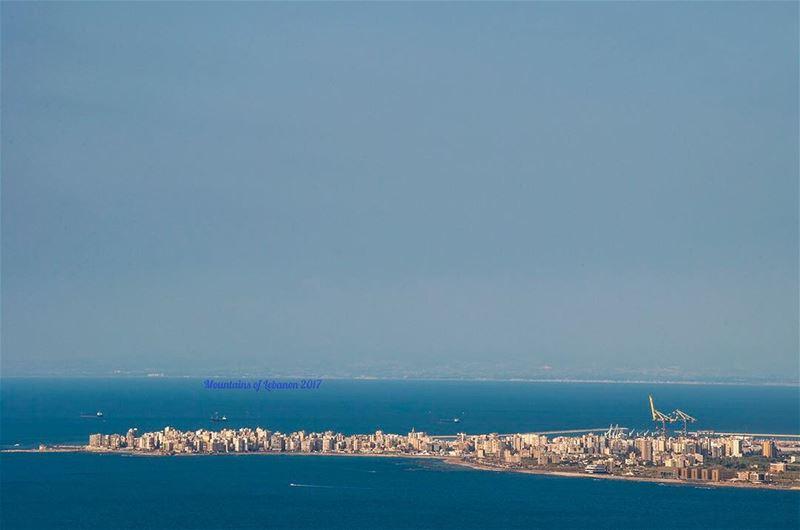 The al-mina, the giant cranes of Tripoli's Port and far lost in the... (Al Mina', Liban-Nord, Lebanon)