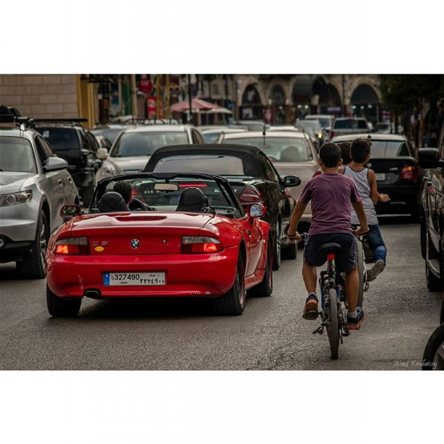 Chasing the big boys  cars  lebanon  street  bikes  kids  streetphoto ... (Aley)